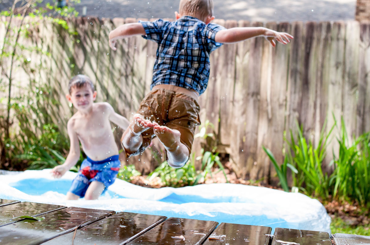 boys jumping in pool